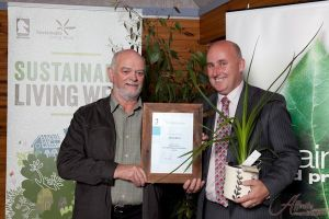 Mayor Andrew Munro presents the award to David Berry